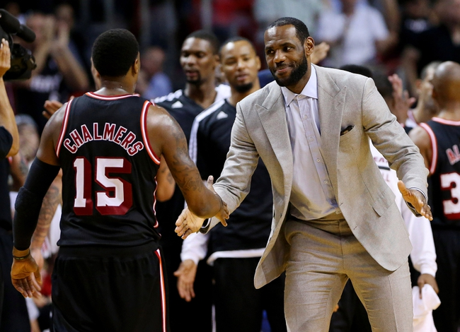 Feb 23, 2014; Miami, FL, USA; Miami Heat small forward LeBron James congratulates point guard Mario Chalmers (15) in the second half of a game against the Chicago Bulls at American Airlines Arena.The Heat won 93-79.  Mandatory Credit: Robert Mayer-USA TODAY Sports