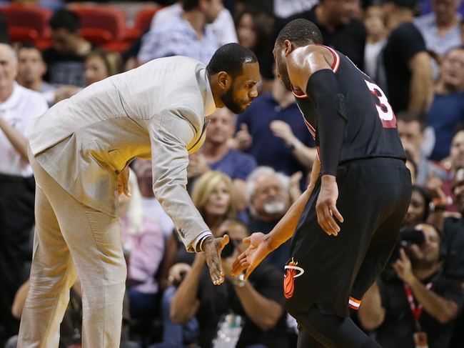 Feb 23, 2014; Miami, FL, USA; Miami Heat small forward LeBron James give shooting guard Dwyane Wade (3) a low five in the second half of a game against the Chicago Bulls at American Airlines Arena.The Heat won 93-79.  Mandatory Credit: Robert Mayer-USA TODAY Sports