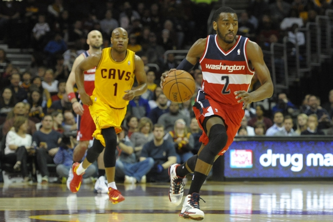 Feb 23, 2014; Cleveland, OH, USA; Washington Wizards point guard John Wall (2) dribbles the ball in the first quarter against the Cleveland Cavaliers at Quicken Loans Arena. Mandatory Credit: David Richard-USA TODAY Sports