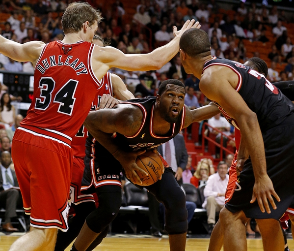 Feb 23, 2014; Miami, FL, USA;  Miami Heat center Greg Oden (20) grabs a rebound against Chicago Bulls small forward Mike Dunleavy (34) in the second half at American Airlines Arena.The Heat won 93-79.  Mandatory Credit: Robert Mayer-USA TODAY Sports