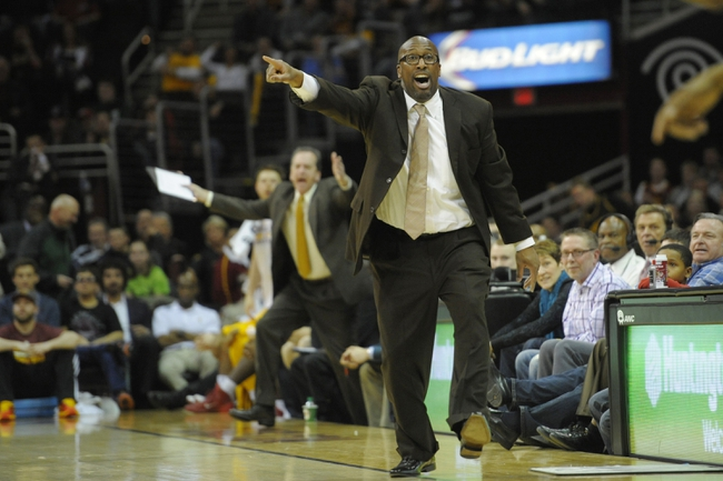 Feb 23, 2014; Cleveland, OH, USA; Cleveland Cavaliers head coach Mike Brown reacts in the fourth quarter against the Washington Wizards at Quicken Loans Arena. Mandatory Credit: David Richard-USA TODAY Sports