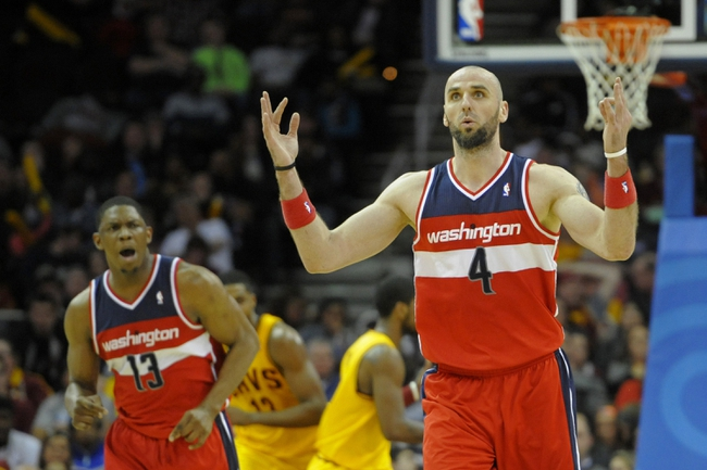 Feb 23, 2014; Cleveland, OH, USA; Washington Wizards center Marcin Gortat (4) reacts to his basket with center Kevin Seraphin (13) in the fourth quarter against the Cleveland Cavaliers at Quicken Loans Arena. Mandatory Credit: David Richard-USA TODAY Sports