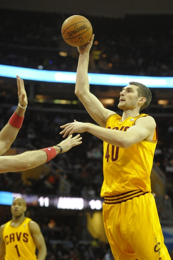 Feb 23, 2014; Cleveland, OH, USA; Cleveland Cavaliers center Tyler Zeller (40) shoots in the third quarter against the Washington Wizards at Quicken Loans Arena. Mandatory Credit: David Richard-USA TODAY Sports
