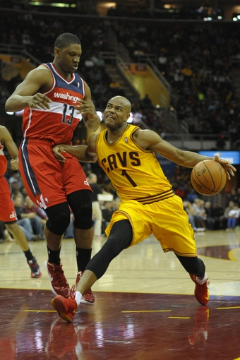 Feb 23, 2014; Cleveland, OH, USA; Cleveland Cavaliers point guard Jarrett Jack (1) drives against Washington Wizards center Kevin Seraphin (13) in the third quarter at Quicken Loans Arena. Mandatory Credit: David Richard-USA TODAY Sports