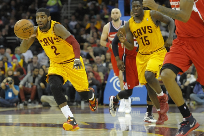 Feb 23, 2014; Cleveland, OH, USA; Cleveland Cavaliers point guard Kyrie Irving (2) starts the fast break in the third quarter against the Washington Wizards at Quicken Loans Arena. Mandatory Credit: David Richard-USA TODAY Sports