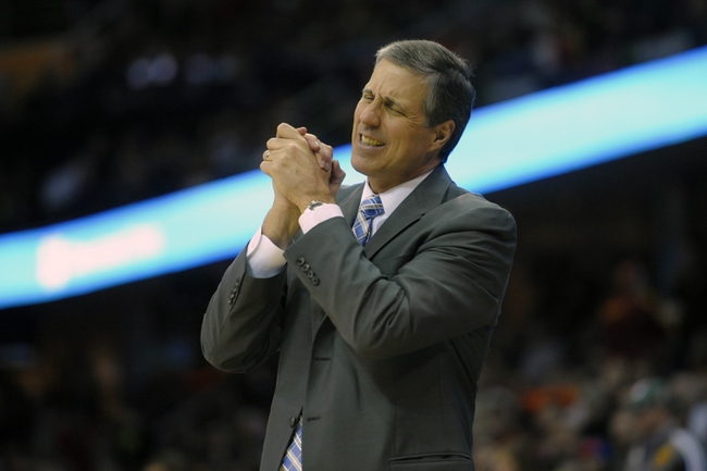Feb 23, 2014; Cleveland, OH, USA; Washington Wizards head coach Randy Wittman reacts in the fourth quarter against the Cleveland Cavaliers at Quicken Loans Arena. Mandatory Credit: David Richard-USA TODAY Sports