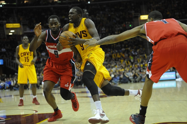 Feb 23, 2014; Cleveland, OH, USA; Cleveland Cavaliers small forward Luol Deng (9) drives against Washington Wizards small forward Martell Webster (9) in the third quarter at Quicken Loans Arena. Mandatory Credit: David Richard-USA TODAY Sports