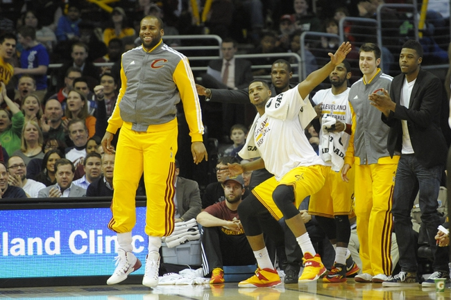 Feb 23, 2014; Cleveland, OH, USA; Cleveland Cavaliers center Arinze Onuaku (left) and power forward Tristan Thompson (second from left) celebrate on the bench in the fourth quarter against the Washington Wizards at Quicken Loans Arena. Mandatory Credit: David Richard-USA TODAY Sports