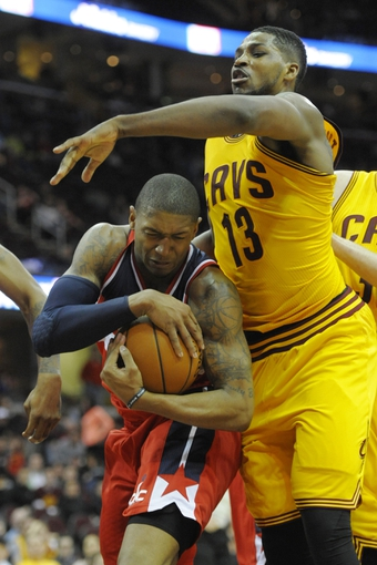 Feb 23, 2014; Cleveland, OH, USA; Washington Wizards shooting guard Bradley Beal (3) rebounds against Cleveland Cavaliers power forward Tristan Thompson (13) in the fourth quarter at Quicken Loans Arena. Mandatory Credit: David Richard-USA TODAY Sports