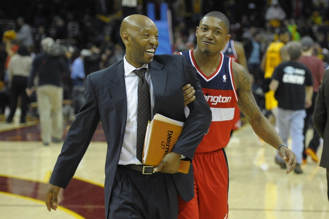 Feb 23, 2014; Cleveland, OH, USA; Washington Wizards assistant coach Sam Cassell (left) and shooting guard Bradley Beal (3) celebrate after a 96-83 win over the Cleveland Cavaliers at Quicken Loans Arena. Mandatory Credit: David Richard-USA TODAY Sports