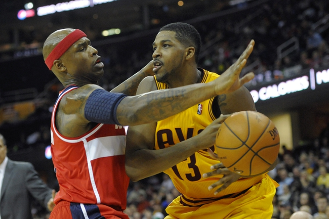 Feb 23, 2014; Cleveland, OH, USA; Washington Wizards power forward Al Harrington (7) defends Cleveland Cavaliers power forward Tristan Thompson (13) in the fourth quarter at Quicken Loans Arena. Mandatory Credit: David Richard-USA TODAY Sports