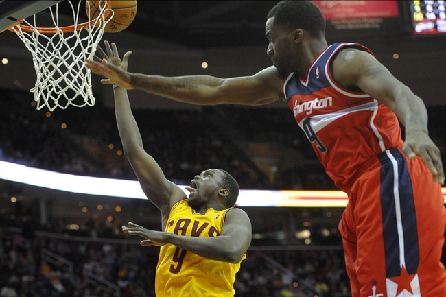Feb 23, 2014; Cleveland, OH, USA; Cleveland Cavaliers small forward Luol Deng (9) shoots against Washington Wizards small forward Martell Webster (9) in the fourth quarter at Quicken Loans Arena. Mandatory Credit: David Richard-USA TODAY Sports
