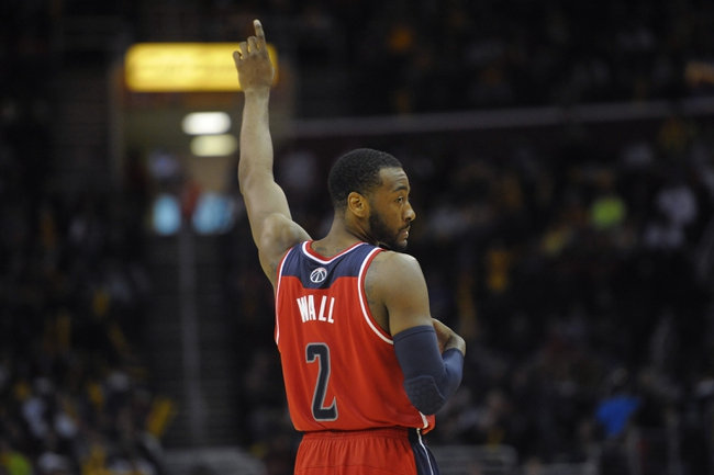 Feb 23, 2014; Cleveland, OH, USA; Washington Wizards point guard John Wall (2) reacts in the fourth quarter against the Cleveland Cavaliers at Quicken Loans Arena. Mandatory Credit: David Richard-USA TODAY Sports