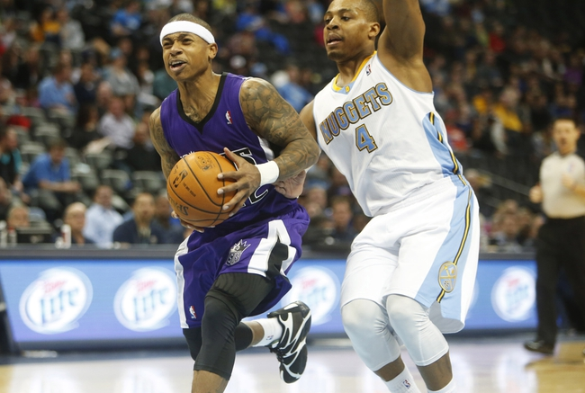 Feb 23, 2014; Denver, CO, USA; Sacramento Kings guard Isaiah Thomas (22) drives to the basket during the second half against the Denver Nuggets at Pepsi Center.  The Kings won 109-95. Mandatory Credit: Chris Humphreys-USA TODAY Sports