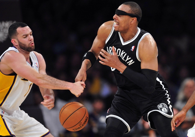February 23, 2014; Los Angeles, CA, USA; Brooklyn Nets small forward Paul Pierce (34) turns the ball over against Los Angeles Lakers point guard Jordan Farmar (1) during the second half at Staples Center. Mandatory Credit: Gary A. Vasquez-USA TODAY Sports