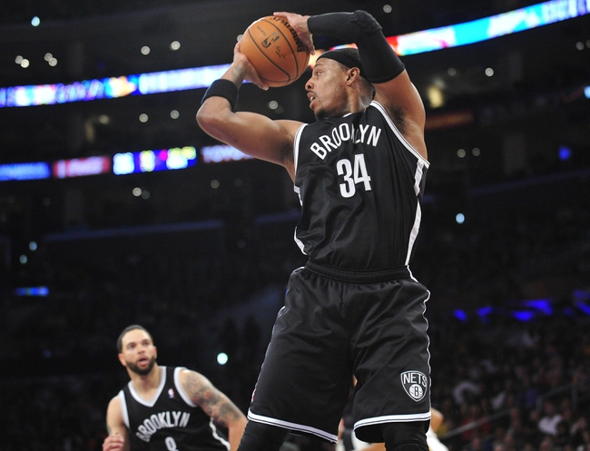 February 23, 2014; Los Angeles, CA, USA; Brooklyn Nets small forward Paul Pierce (34) grabs a rebound against the Los Angeles Lakers during the second half at Staples Center. Mandatory Credit: Gary A. Vasquez-USA TODAY Sports