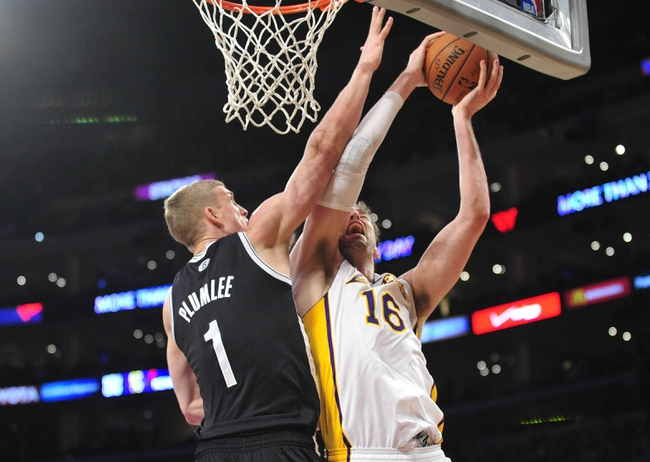 February 23, 2014; Los Angeles, CA, USA; Los Angeles Lakers center Pau Gasol (16) moves to the basket against Brooklyn Nets power forward Mason Plumlee (1) during the second half at Staples Center. Mandatory Credit: Gary A. Vasquez-USA TODAY Sports