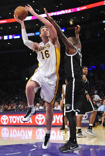 February 23, 2014; Los Angeles, CA, USA; Los Angeles Lakers center Pau Gasol (16) moves to the basket against  Brooklyn Nets center Andray Blatche (0) during the second half at Staples Center. Mandatory Credit: Gary A. Vasquez-USA TODAY Sports