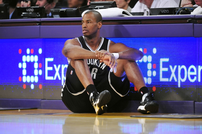 February 23, 2014; Los Angeles, CA, USA; Brooklyn Nets center Jason Collins (46) waits to enter the game against the Los Angeles Lakers during the second half at Staples Center. Mandatory Credit: Gary A. Vasquez-USA TODAY Sports