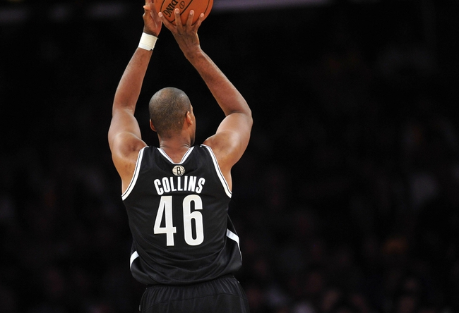 February 23, 2014; Los Angeles, CA, USA; Brooklyn Nets center Jason Collins (46) attempts a shot against the Los Angeles Lakers during the second half at Staples Center. Mandatory Credit: Gary A. Vasquez-USA TODAY Sports