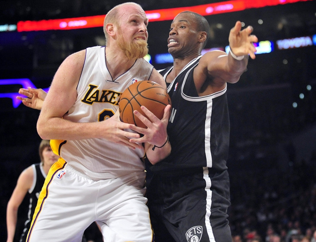 February 23, 2014; Los Angeles, CA, USA; Brooklyn Nets center Jason Collins (46) defends against Los Angeles Lakers center Chris Kaman (9) during the second half at Staples Center. Mandatory Credit: Gary A. Vasquez-USA TODAY Sports