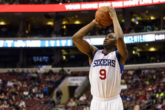 Feb 21, 2014; Philadelphia, PA, USA; Philadelphia 76ers guard James Anderson (9) shoots a jump shot during the fourth quarter against the Dallas Mavericks at the Wells Fargo Center. The Mavericks defeated the Sixers 124-112. Mandatory Credit: Howard Smith-USA TODAY Sports