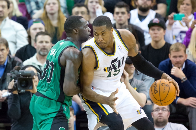Feb 24, 2014; Salt Lake City, UT, USA; Boston Celtics power forward Brandon Bass (30) defends Utah Jazz center Derrick Favors (15) during the first half at EnergySolutions Arena. Mandatory Credit: Russ Isabella-USA TODAY Sports