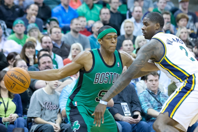 Feb 24, 2014; Salt Lake City, UT, USA; Utah Jazz power forward Marvin Williams (2) defends against Boston Celtics point guard Rajon Rondo (9) during the first half at EnergySolutions Arena. Mandatory Credit: Russ Isabella-USA TODAY Sports