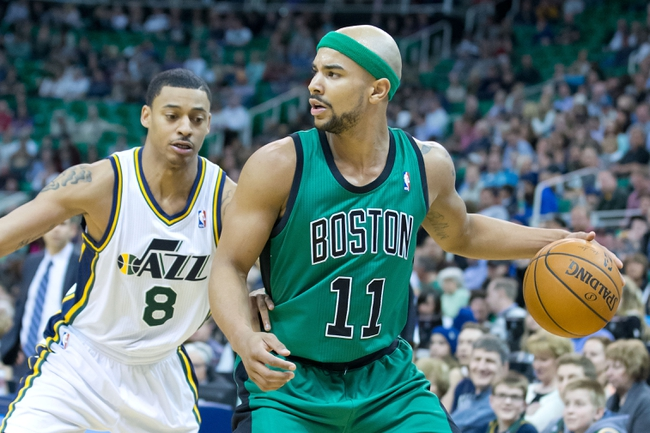 Feb 24, 2014; Salt Lake City, UT, USA; Boston Celtics point guard Jerryd Bayless (11) dribbles the ball in front of Utah Jazz point guard Diante Garrett (8) during the first half at EnergySolutions Arena. Mandatory Credit: Russ Isabella-USA TODAY Sports