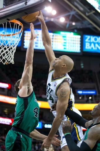 Feb 24, 2014; Salt Lake City, UT, USA; Utah Jazz small forward Richard Jefferson (24) dunks the ball over Boston Celtics center Kris Humphries (43) during the second half at EnergySolutions Arena. The Jazz won 110-98. Mandatory Credit: Russ Isabella-USA TODAY Sports