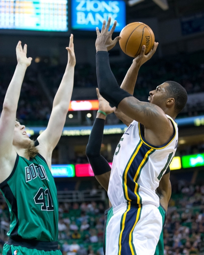 Feb 24, 2014; Salt Lake City, UT, USA; Utah Jazz center Derrick Favors (15) shoots the ball over Boston Celtics center Kelly Olynyk (41) during the second half at EnergySolutions Arena. The Jazz won 110-98. Mandatory Credit: Russ Isabella-USA TODAY Sports