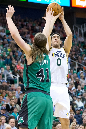 Feb 24, 2014; Salt Lake City, UT, USA; Utah Jazz center Enes Kanter (0) shoots the ball over Boston Celtics center Kelly Olynyk (41) during the second half at EnergySolutions Arena. The Jazz won 110-98. Mandatory Credit: Russ Isabella-USA TODAY Sports