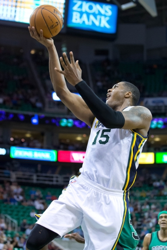 Feb 24, 2014; Salt Lake City, UT, USA; Utah Jazz center Derrick Favors (15) shoots the ball during the second half against the Boston Celtics at EnergySolutions Arena. The Jazz won 110-98. Mandatory Credit: Russ Isabella-USA TODAY Sports