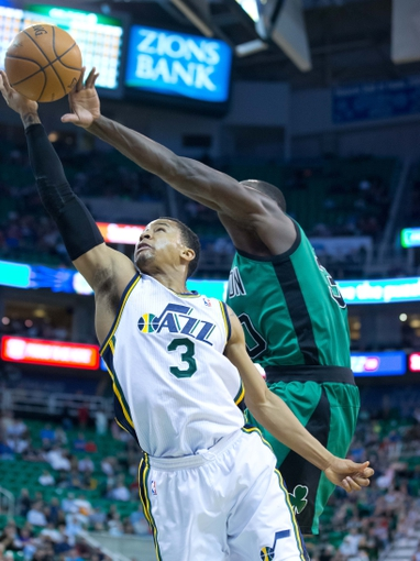 Feb 24, 2014; Salt Lake City, UT, USA; Boston Celtics power forward Brandon Bass (30) blocks the shot by Utah Jazz point guard Trey Burke (3) during the second half at EnergySolutions Arena. The Jazz won 110-98. Mandatory Credit: Russ Isabella-USA TODAY Sports