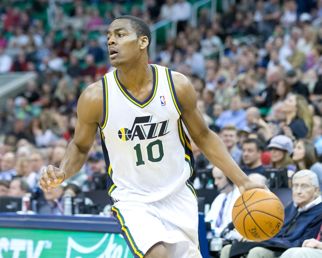 Feb 24, 2014; Salt Lake City, UT, USA; Utah Jazz point guard Alec Burks (10) dribbles the ball during the second half against the Boston Celtics at EnergySolutions Arena. The Jazz won 110-98. Mandatory Credit: Russ Isabella-USA TODAY Sports