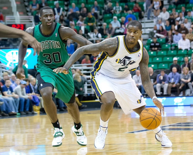 Feb 24, 2014; Salt Lake City, UT, USA; Utah Jazz power forward Marvin Williams (2) dribbles the ball in front of Boston Celtics power forward Brandon Bass (30) during the second half at EnergySolutions Arena. The Jazz won 110-98. Mandatory Credit: Russ Isabella-USA TODAY Sports