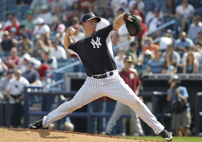 Feb 25, 2014; Tampa, FL, USA; New York Yankees relief pitcher Brian Gordon (71) throws a pitch during the third inning against the Florida State Seminoles s at George M. Steinbrenner Field. Mandatory Credit: Kim Klement-USA TODAY Sports