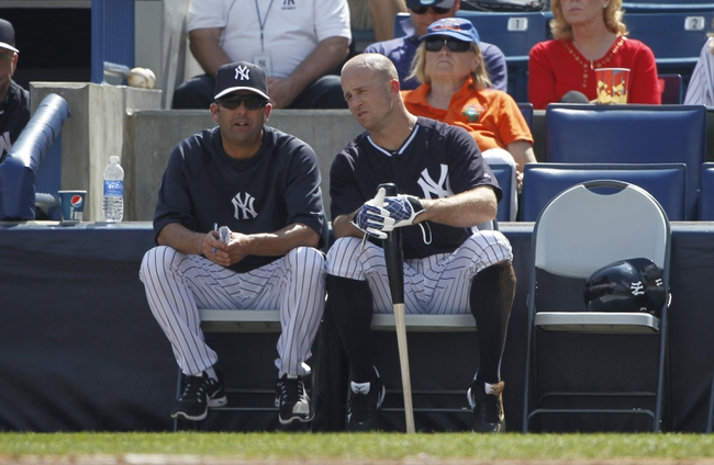 Feb 25, 2014; Tampa, FL, USA; New York Yankees batting coach Kevin Long (54) and New York Yankees center fielder Brett Gardner (11) talk during the third inning against the  Florida State Seminoles at George M. Steinbrenner Field. Mandatory Credit: Kim Klement-USA TODAY Sports