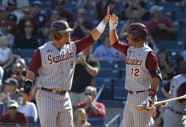 Feb 25, 2014; Tampa, FL, USA; Florida State Seminoles  outfielder DJ Stewart (8) high five after infielder John Sansone (12) after he scoredon infielder Casey Smit (43) (not pictured) 3-RBI double during the sixth inning against the New York Yankees at George M. Steinbrenner Field. Mandatory Credit: Kim Klement-USA TODAY Sports