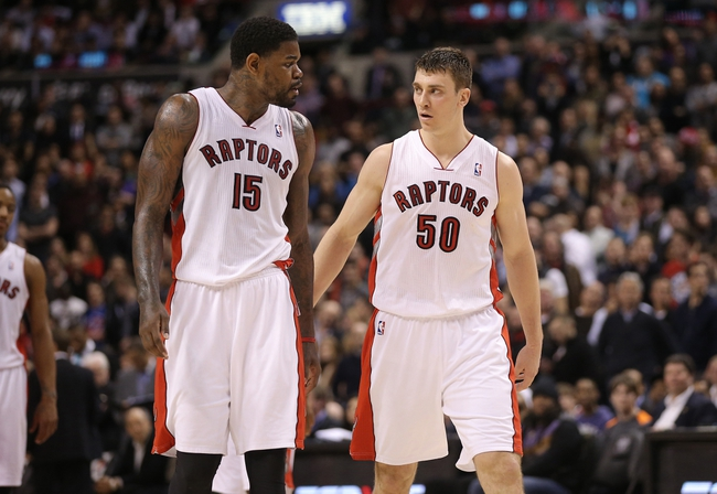 Feb 19, 2014; Toronto, Ontario, CAN; Toronto Raptors forward Tyler Hansbrough (50) with forward Amir Johnson (15) against the Chicago Bulls at Air Canada Centre. The Bulls beat the Raptors 94-92. Mandatory Credit: Tom Szczerbowski-USA TODAY Sports