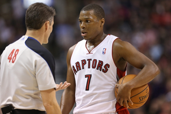 Feb 19, 2014; Toronto, Ontario, CAN; Toronto Raptors point guard Kyle Lowry (7) questions a call with official Scott Foster (48) against the Chicago Bulls at Air Canada Centre. The Bulls beat the Raptors 94-92. Mandatory Credit: Tom Szczerbowski-USA TODAY Sports