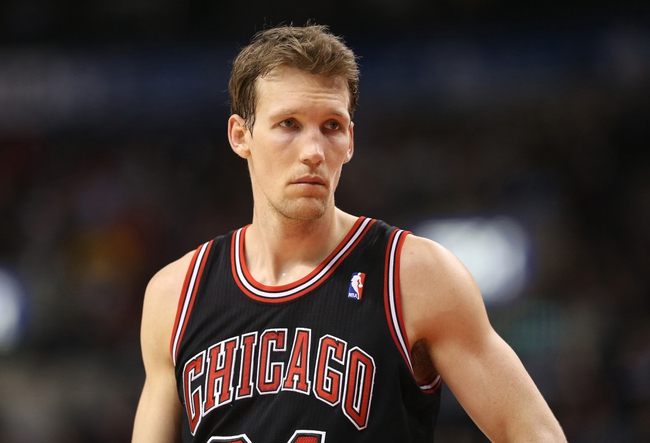 Feb 19, 2014; Toronto, Ontario, CAN; Chicago Bulls forward Mike Dunleavy (34) during the game against the Toronto Raptors at Air Canada Centre. The Bulls beat the Raptors 94-92. Mandatory Credit: Tom Szczerbowski-USA TODAY Sports