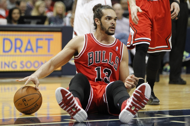 Feb 25, 2014; Atlanta, GA, USA; Chicago Bulls center Joakim Noah (13) reacts after a foul call against the Atlanta Hawks in the second quarter at Philips Arena. Mandatory Credit: Brett Davis-USA TODAY Sports