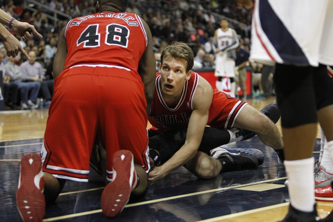 Feb 25, 2014; Atlanta, GA, USA; Chicago Bulls small forward Mike Dunleavy (34) and center Nazr Mohammed (48) reach for a loose ball against the Atlanta Hawks in the second quarter at Philips Arena. Mandatory Credit: Brett Davis-USA TODAY Sports