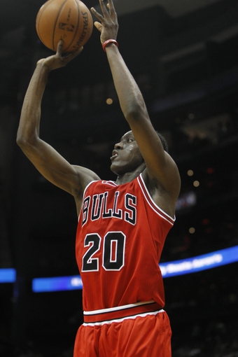 Feb 25, 2014; Atlanta, GA, USA; Chicago Bulls shooting guard Tony Snell (20) shoots the ball against the Atlanta Hawks in the second quarter at Philips Arena. Mandatory Credit: Brett Davis-USA TODAY Sports