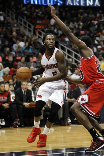 Feb 25, 2014; Atlanta, GA, USA; Atlanta Hawks small forward DeMarre Carroll (5) drives to the basket against the Chicago Bulls in the third quarter at Philips Arena. Mandatory Credit: Brett Davis-USA TODAY Sports