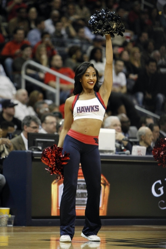 Feb 25, 2014; Atlanta, GA, USA; Atlanta Hawks cheerleader performs against the Chicago Bulls in the fourth quarter at Philips Arena. The Bulls defeated the Hawks 107-103. Mandatory Credit: Brett Davis-USA TODAY Sports