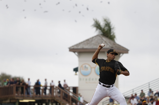 Feb 26, 2014; Bradenton, FL, USA; Pittsburgh Pirates relief pitcher Jeanmar Gomez (30) throws a pitch during the third inning against the New York Yankees at McKechnie Field. Mandatory Credit: Kim Klement-USA TODAY Sports