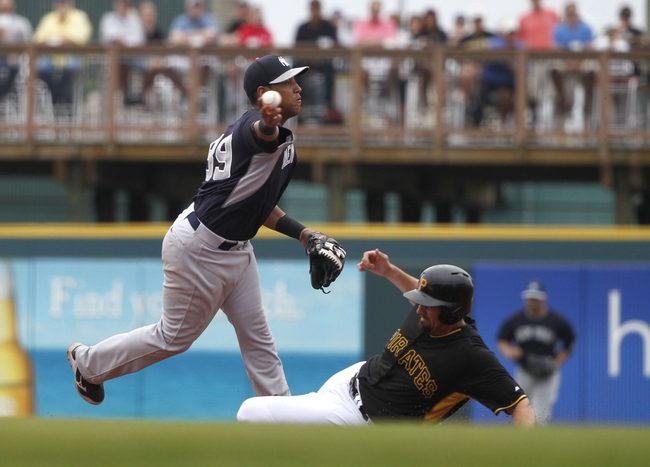 Feb 26, 2014; Bradenton, FL, USA; New York Yankees second baseman Yangervis Solarte (89) forces out Pittsburgh Pirates first baseman Gaby Sanchez (17) and throws the ball to first for a double play during the third inning at McKechnie Field. Mandatory Credit: Kim Klement-USA TODAY Sports