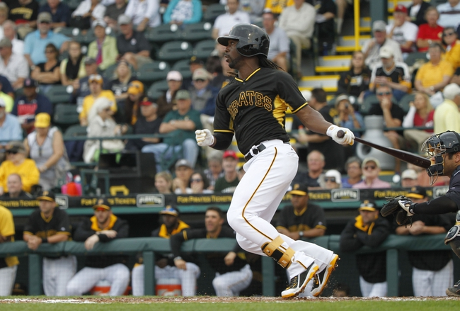 Feb 26, 2014; Bradenton, FL, USA; Pittsburgh Pirates center fielder Andrew McCutchen (22) single during the fifth inning against the New York Yankees at McKechnie Field. Mandatory Credit: Kim Klement-USA TODAY Sports
